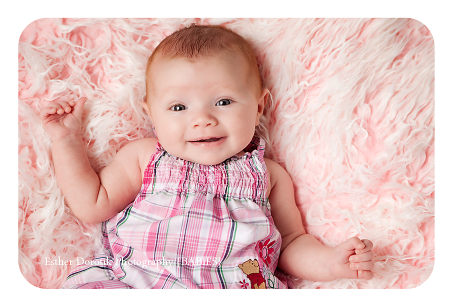 infant-baby-laying-on-pink-fur-dallas-photographer