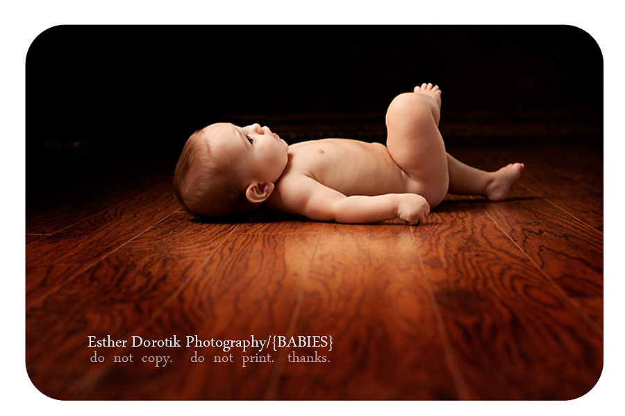 picture-of-6-month-old-baby-boy-laying-on-back-posing-with-foot-crossed-over-knee