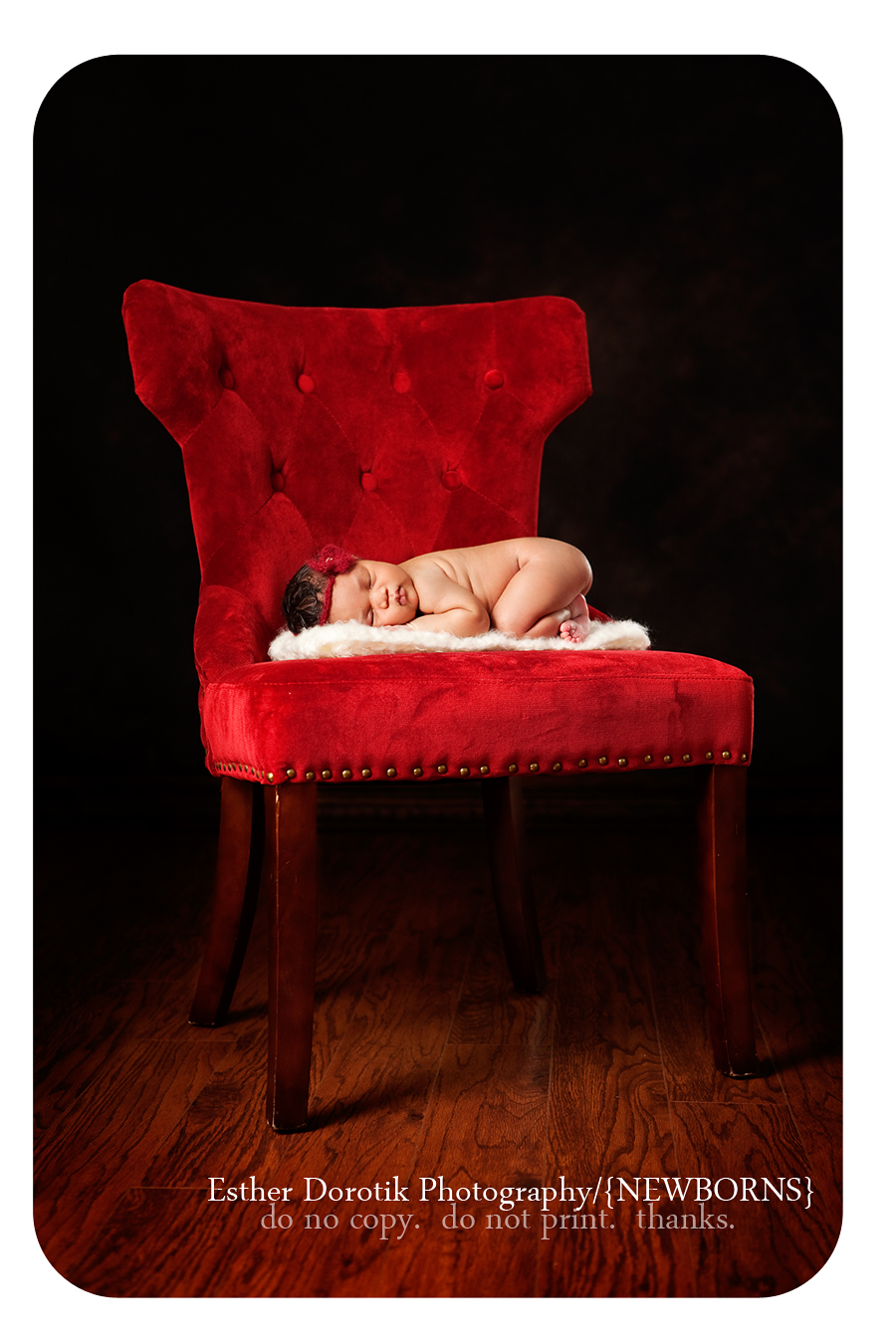 5-day-old-newborn-baby-laying-on-soft-red-chair