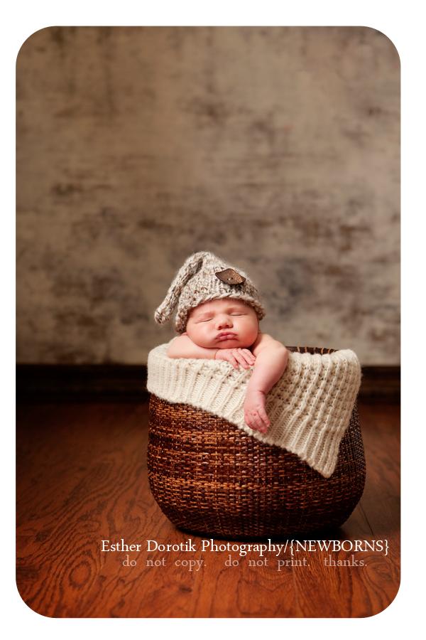 photograph-of-newborn-boy-in-basket-with-elf-hat-taken-in-Dallas