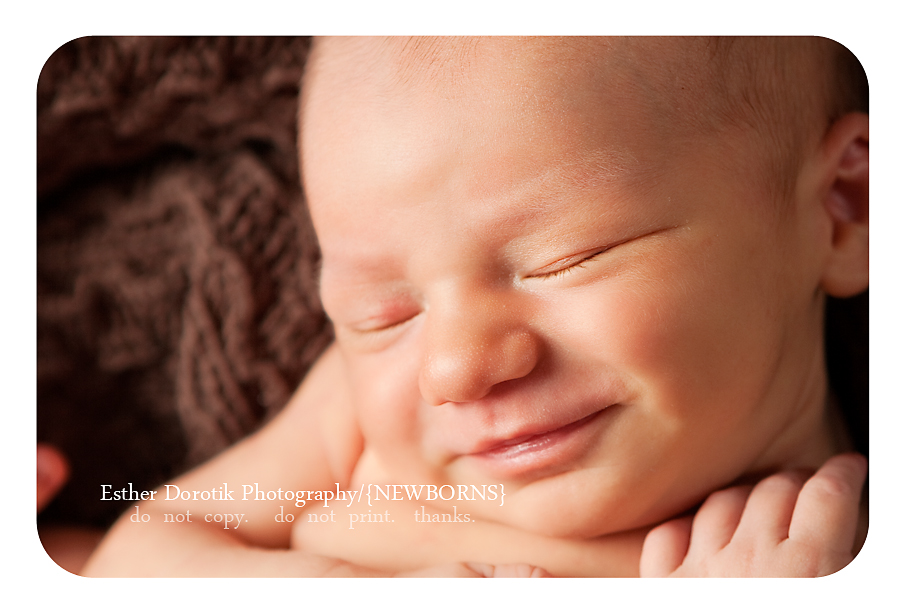 close-up-photograph-of-newborn-baby-boy-smiling