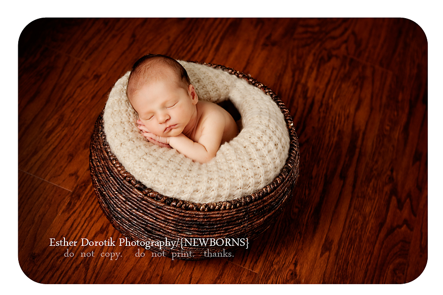 10-day-old-newborn-boy-in-basket-with-cream-blanket