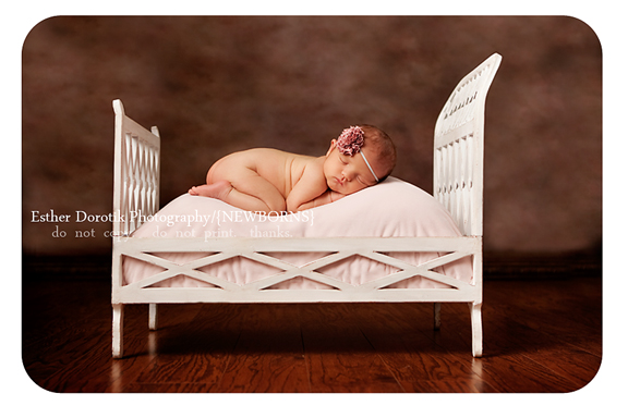 newborn-photography-of-baby-in-chic-bed-with-pink-headband