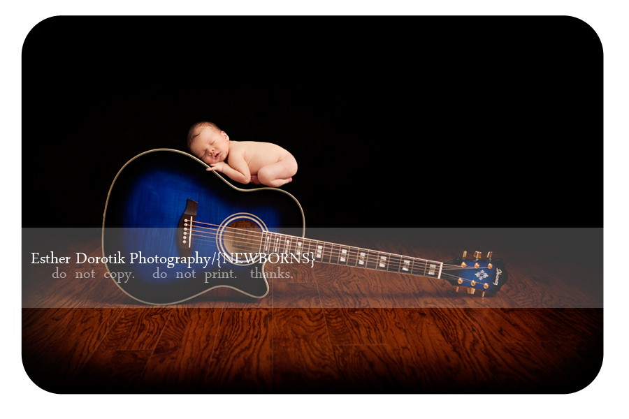 unique-newborn-photograph-of-baby-boy-laying-on-blue-guitar
