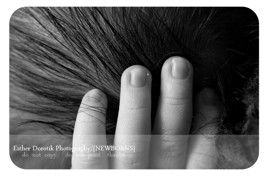 close-up-photography-of-newborn-hand-in-his-hair