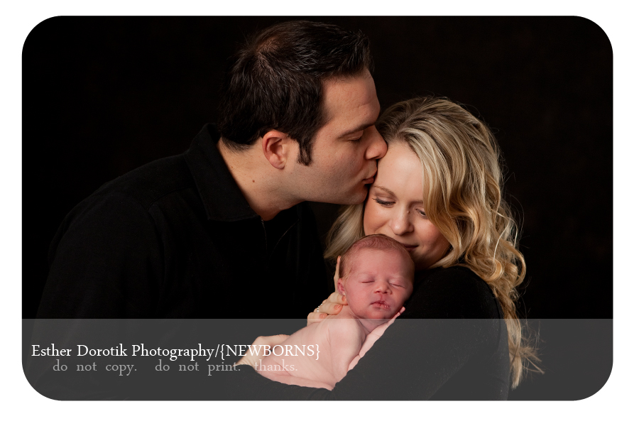 newborn-family-with-mom-dad-and-6-day-old-baby-girl