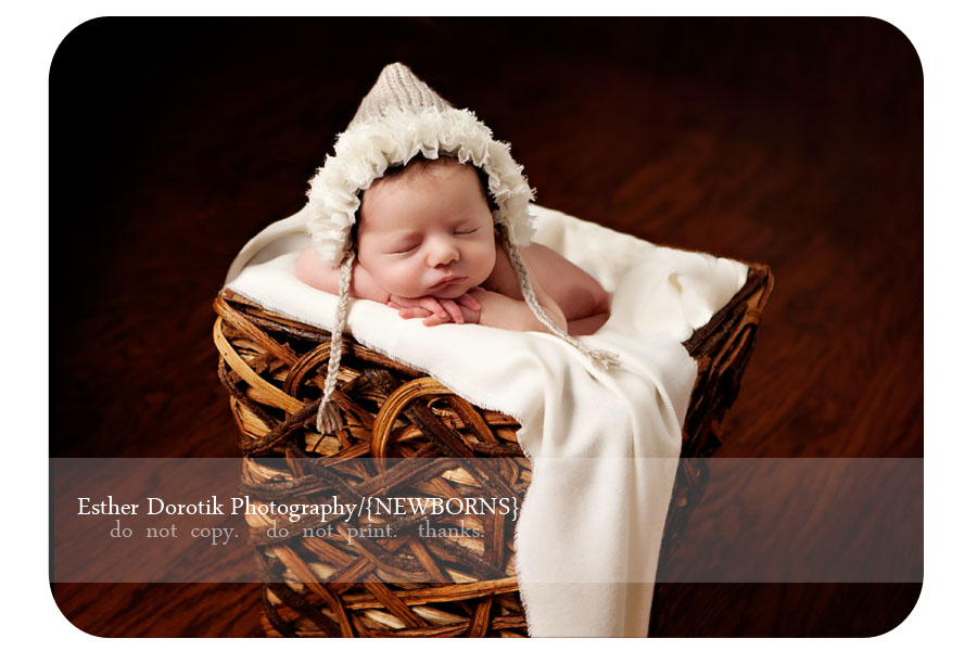 newborn-photographer-captures-infant-girl-with-knit-flower-bonnet