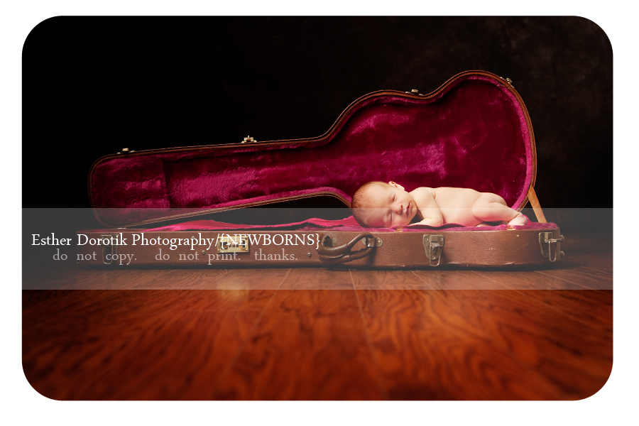 newborn-baby-boy-laying-in-guitar-case-with-red-lining