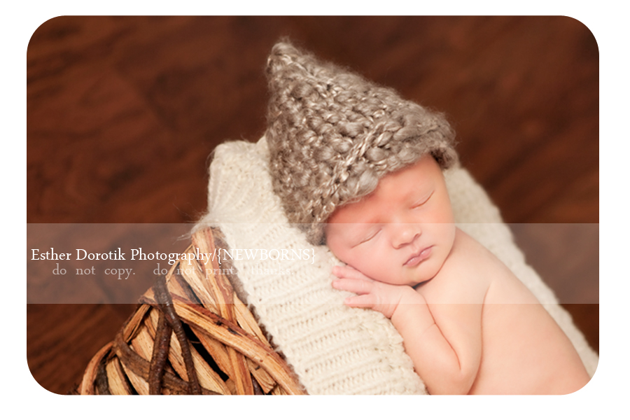 newborn-boy-laying-in-wood-bowl-with-knit-hat-taken-by-Dallas-photographer