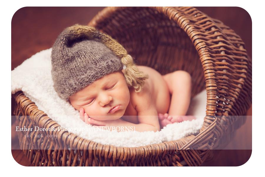 newborn-baby-boy-laying-in-basket-with-cream-blanket
