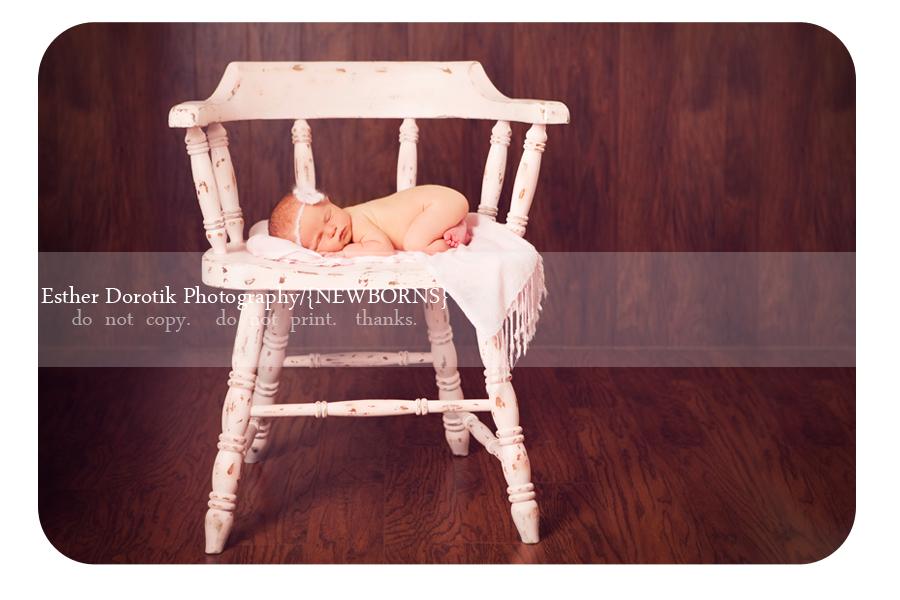 newborn-baby-on-chair-photographed-by-best-newborn-photographer