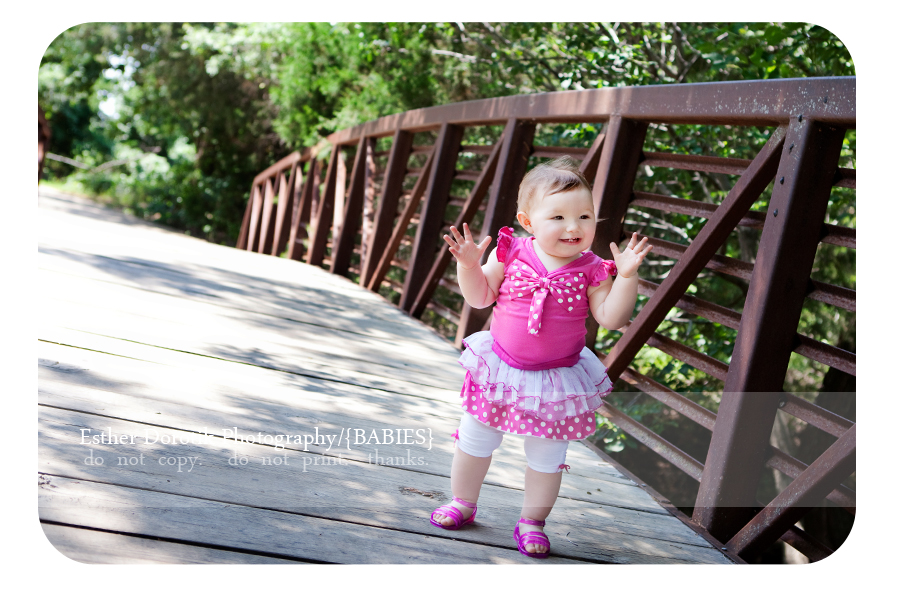 picture-of-one-year-old-girl-walking-on-bridge-in-Flower-Mound-creek-area