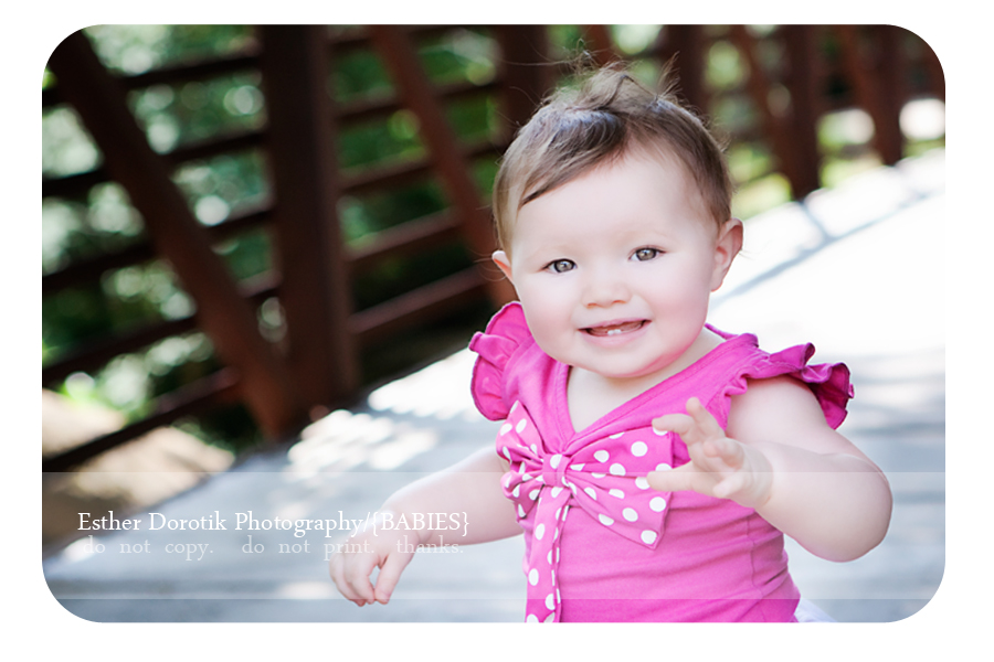 photo-of-one-year-old-baby-standing-with-hands-in-air-taken-by-Dallas-photographer
