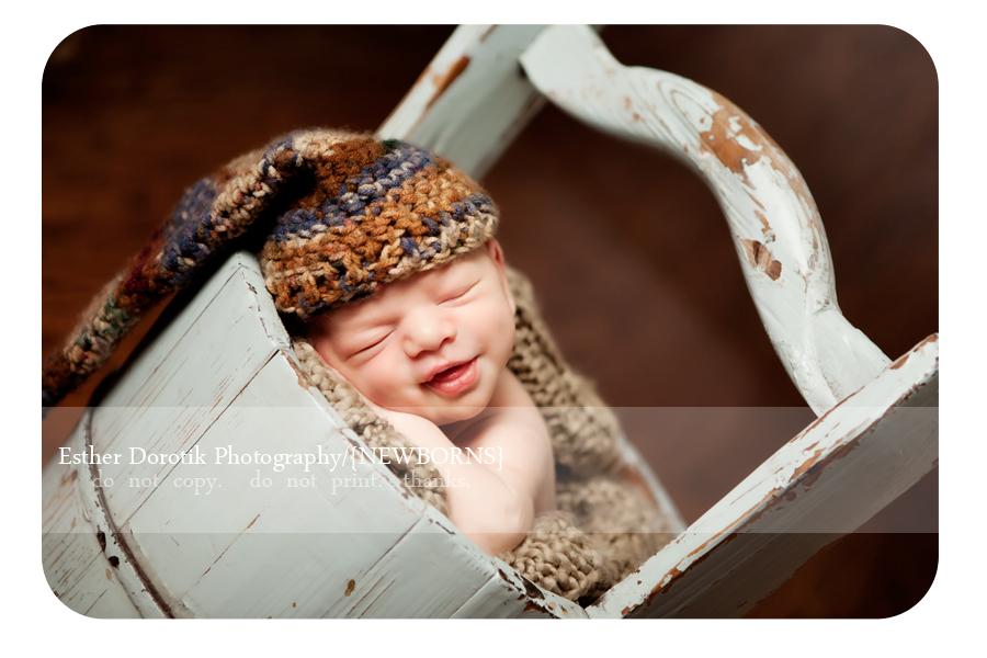 Picture of smiling newborn baby boy in water