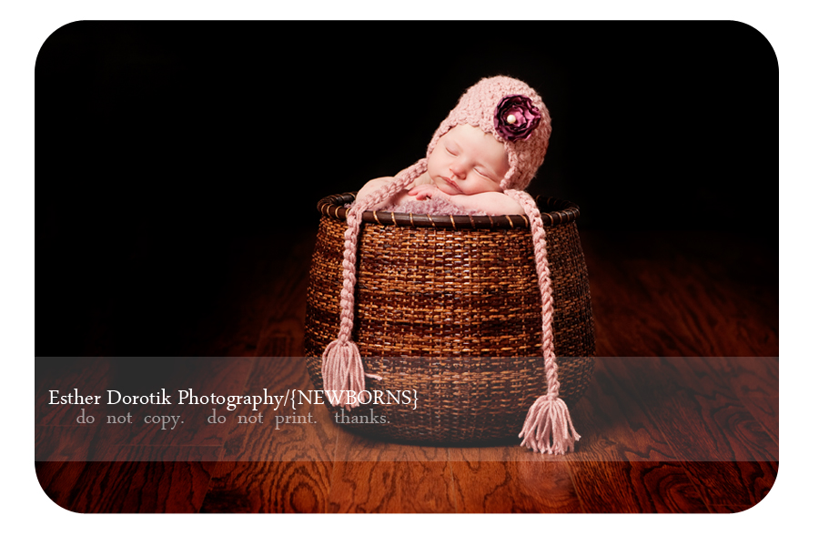Southlake-newborn-photographer-takes-picture-of-baby-in-basket-with-hat