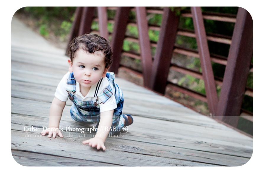 infant-photography-of-baby-boy-crawling-on-bridge