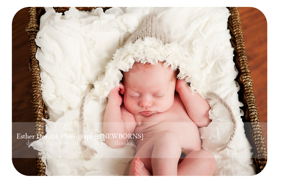 picture-of-baby-girl-laying-in-basket-with-knit-hat-on-taken-by-best-Dallas-photographer