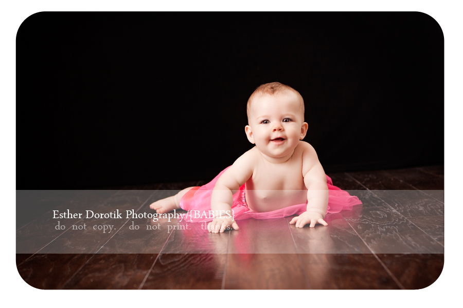 baby-girl-6-month-session-laying-on-studio-floor-with-tutu-on