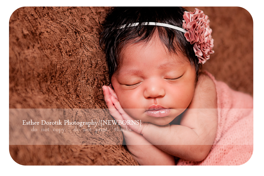 newborn-baby-captured-by-Denton-photographer-laying-on-side-with-her-hands-beside-her-cheeks
