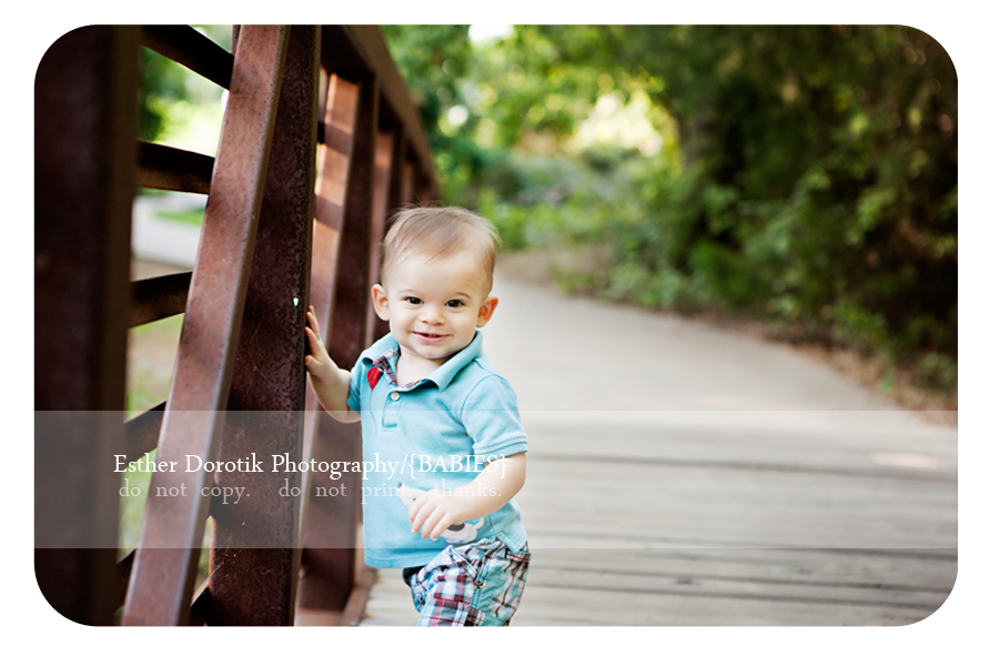 9-month-old-boy-holding-on-to-bridge-photographed-by-Dallas-photographer