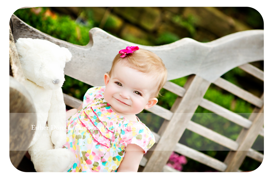 baby-picture-of-9-month-sitting-on-wooden-bench-with-bear