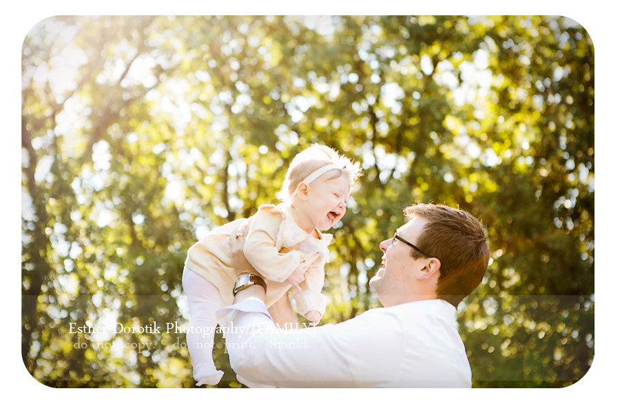 fun-outdoor-family-session-with-daddy-throwing-baby-in-air-smiling