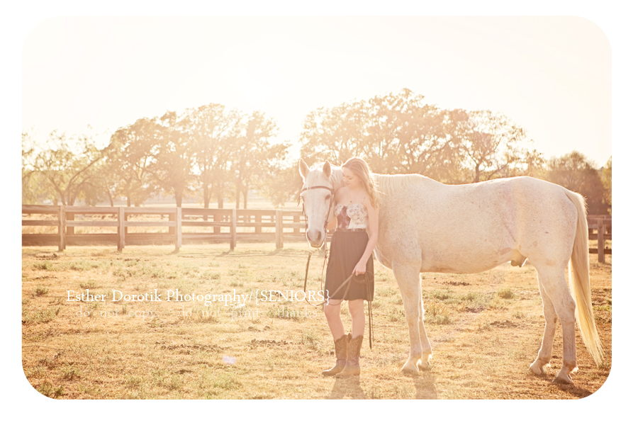 Flower-Mound-senior-photographer-captures-girl-wearing-dress-and-boots-holding-horse-with-sunflare