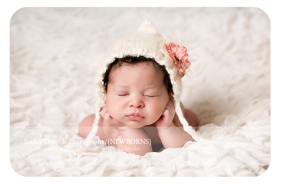 7-day-old-newborn-with-hands-under-her-chin-on-cream-blanket-by-Dallas-baby-photographer