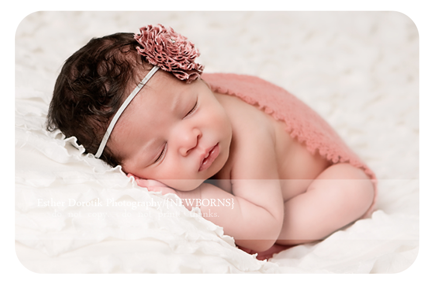 Dallas-Fort-worth-baby-photographer-captures-newborn-girl-in-taco-pose-with-pink-headband-and-wrap