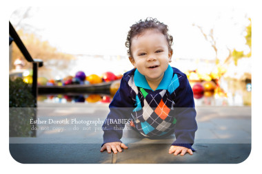 one-year-old-boy-climbing-stairs-at-Dallas-Arboretum-with-glass-show-behind-him