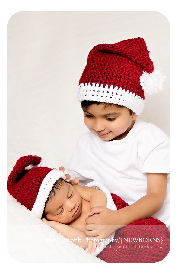 picture-of-brothers-laying-on-blanket-with-Santa-hats-on-taken-by-Dallas-family-photographer
