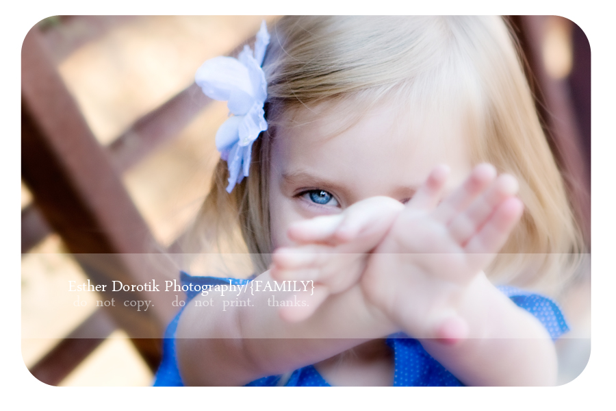 unique-close-up-of-toddler-with-her-hands-up-and-big-blue-eyes-taken-by-Dallas-newborn-baby-photographer