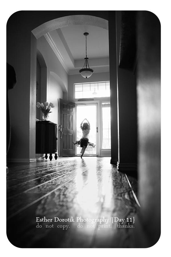 Grapevine-baby-photographer-captures-little-girl-twirling-in-door