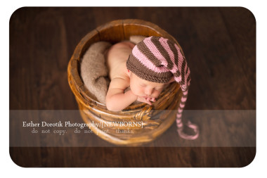 newborn-girl-laying-in-basket-with-pink-and-brown-stocking-hat-taken-by-Plano-newborn-photographer