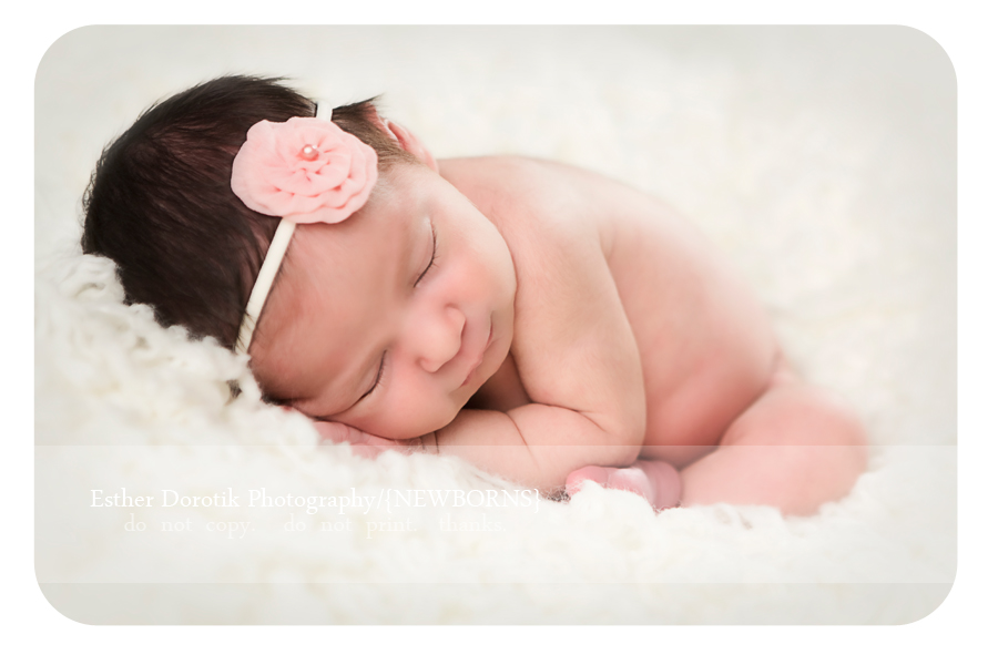 Denton-newborn-photographer-photographs-7-day-old-baby-girl-in-taco-pose-with-headband