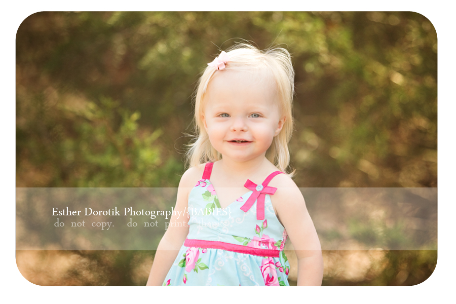 Plano-newborn-baby-photography-of-18-month-old-little-girl-outside-with-sundress-on