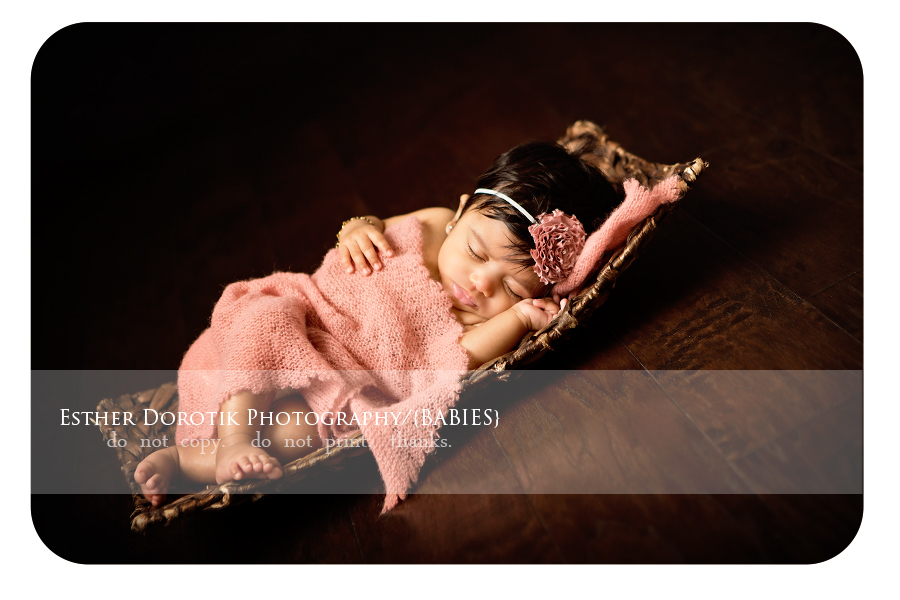 3-month-photography-of-sleeping-baby-girl-in-pink-wrap-with-headband-on