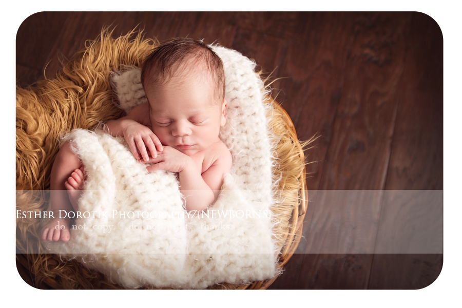 newborn-baby-photo-of-7-day-old-boy-laying-in-basket-with-knit-wrap-by-Grapevine-newborn-photographer