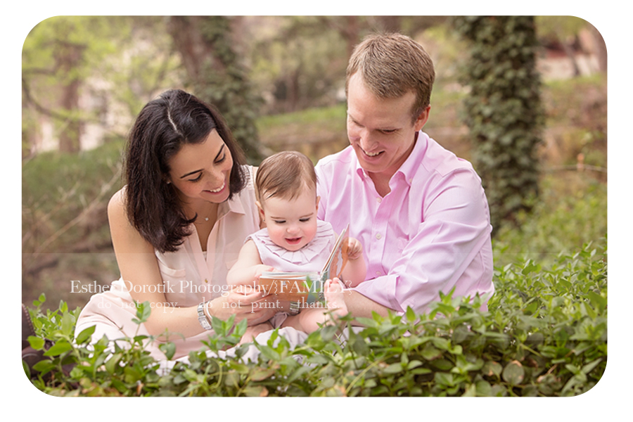 family-picture-of-one-year-old-and-parents-reading-book-by-Plano-family-photographer
