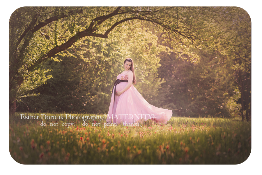 expectant-picture-of-pregnant-mom-in-pink-flowing-dress-standing-under-tree-by-Dallas-newborn-photographer