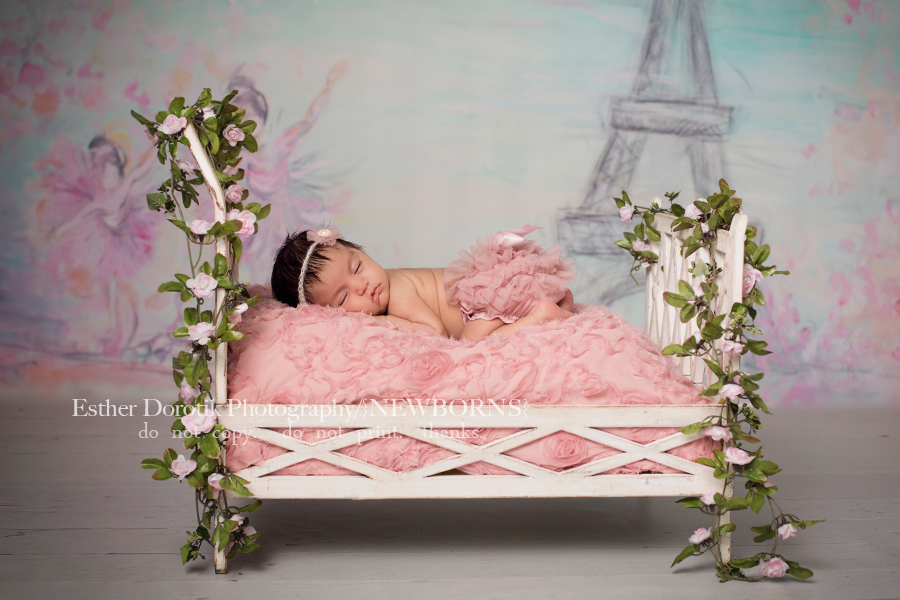 4-week-old-newborn-picture-of-baby-girl-in-tutu-laying-on-bed-by-Dallas-newborn-photographer