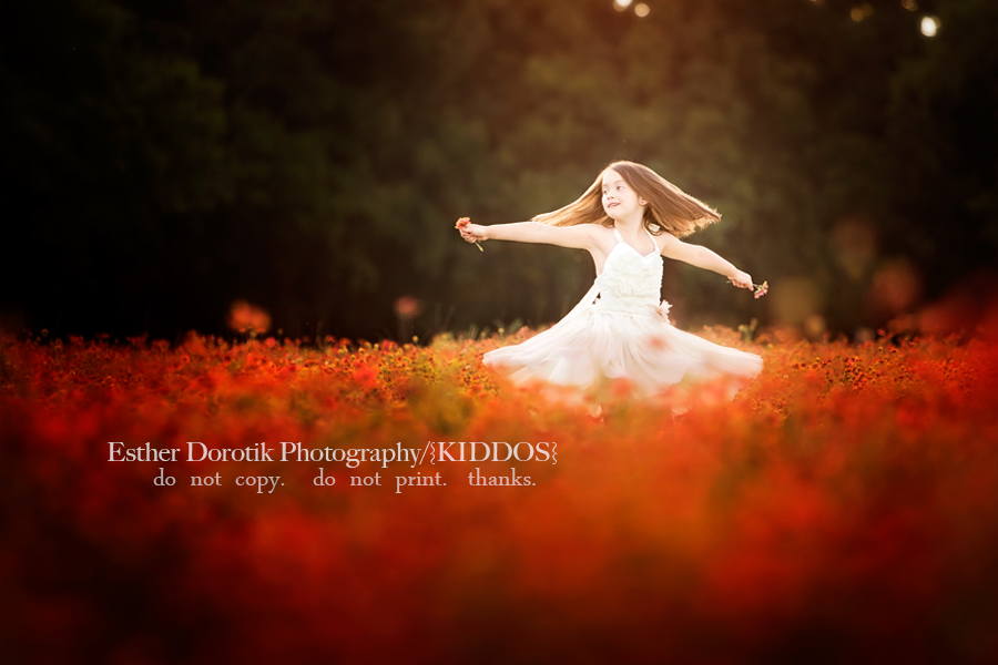 picture-of-6-year-old-dancing-in-flower-field-with-cream-dress-by-Frisco-child-photographer