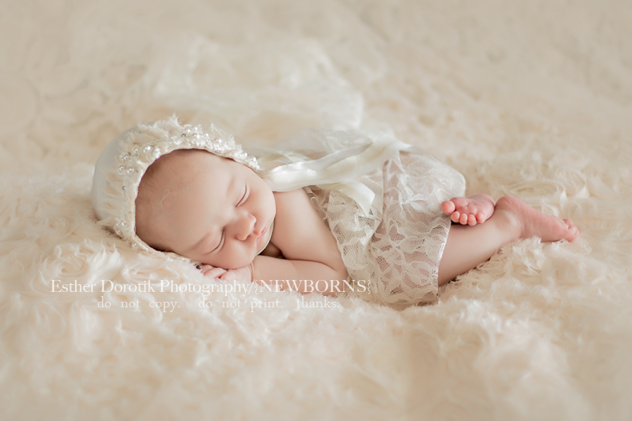 3-week-old-newborn-baby-girl-wrapped-in-lace-with-pearl-bonnet-by-Southlake-newborn-photographer