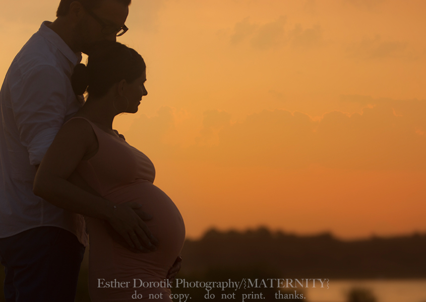 silhouette-picture-of-expecting-couple-watching-sunrise-over-lake-by-Southlake-maternity-photographer